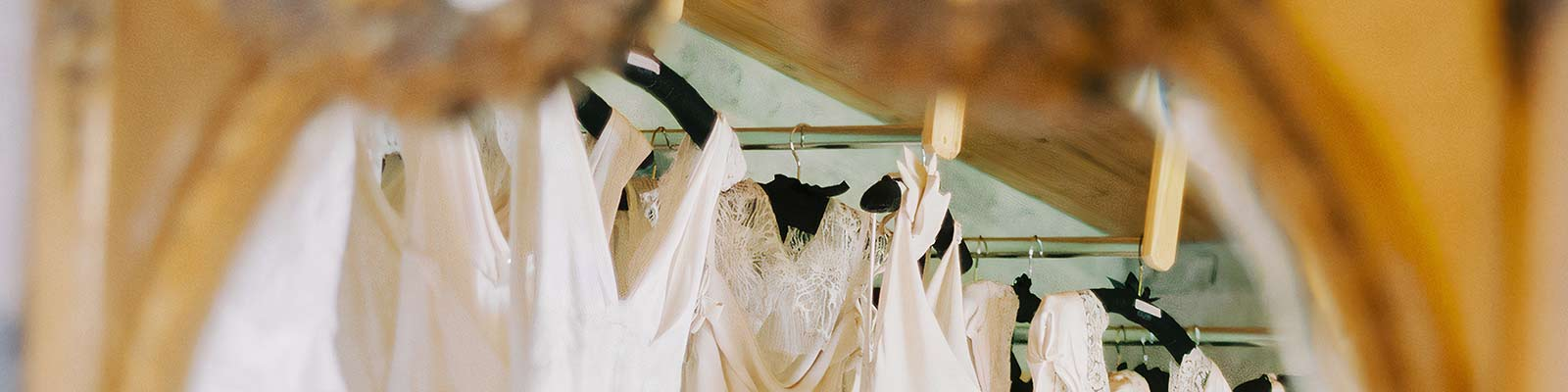 bridal dresses in a mirror at Delphines studio in Ireland